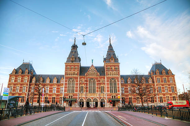 Netherlands national museum in Amsterdam Amsterdam, The Netherlands - April 16, 2015: Netherlands national museum with people in Amsterdam. The Rijksmuseum is dedicated to arts and history in Amsterdam. museumplein stock pictures, royalty-free photos & images
