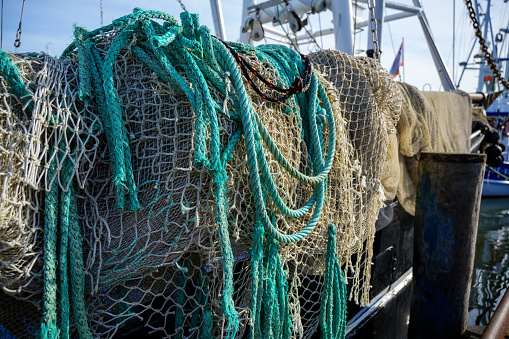 nets and ropes, equipment on a fishing boat in the harbor,