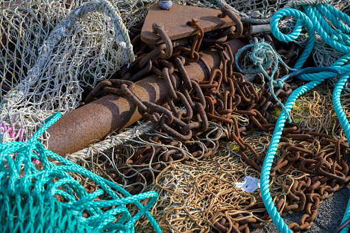nets, rusty chains and ropes, equipment on a fishing boat