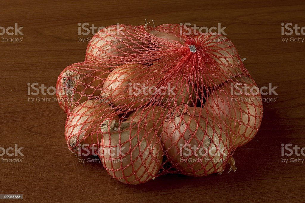 netted onions royalty-free stock photo