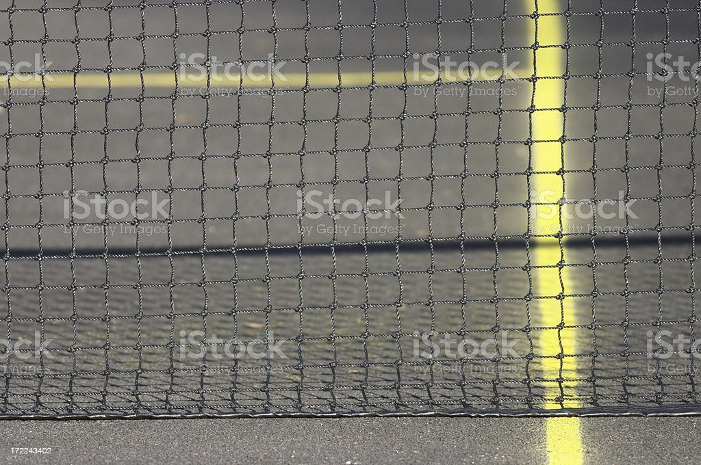 Tennis net and yellow court markings selective focus royalty-free stock photo