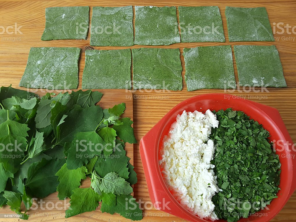 Nettles green ravioli with mushrooms, weed dough, wild plants cooking стоковое фото
