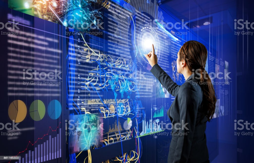 Network administrator in server room. stock photo