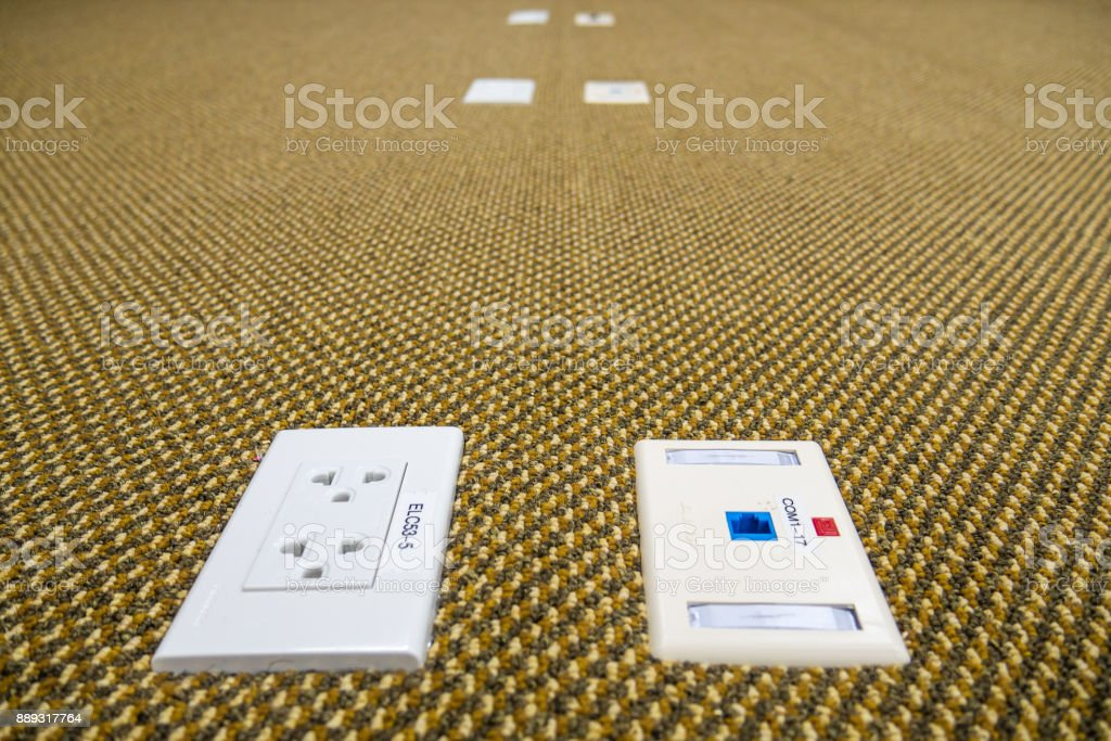 Network and electric outlet on the floor stock photo