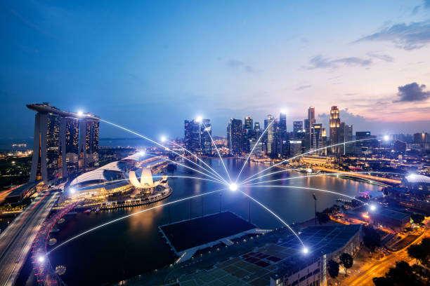 network business connection system on singapore smart city scape in background.network business connection concept - сингапур стоковые фото и изображения