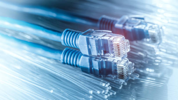 Network cable with high tech technology Fiber optical color background stock photo