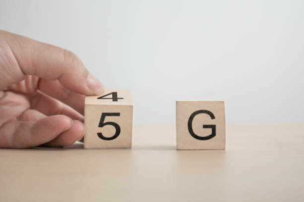 5g (5th generation) network connecting technology future global. hand flip wood cube change number 4g to 5g - 4g foto e immagini stock