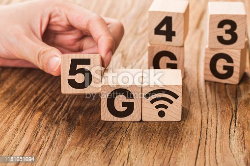 1152653473 istock photo 5G (5th Generation) network connecting technology future global. Hand flip wood cube change number 4G to 5G 1181651694
