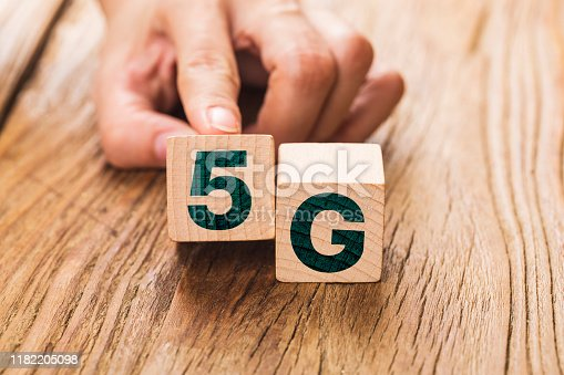 1152653473 istock photo 5G (5th Generation) network connecting technology future global. Hand flip wood cube change number 4G to 5G 1182205098