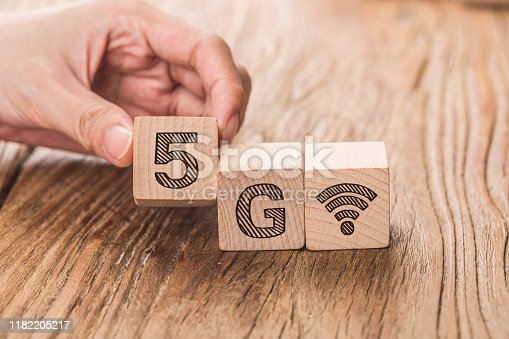 1152653473 istock photo 5G (5th Generation) network connecting technology future global. Hand flip wood cube change number 4G to 5G 1182205217