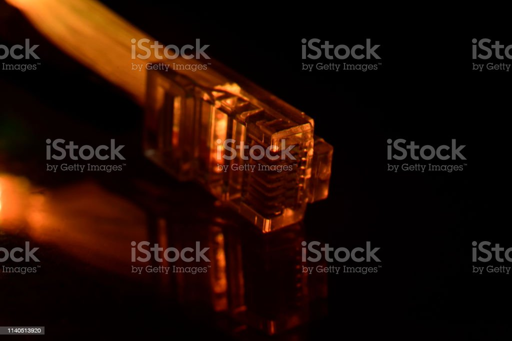 Network connection plug from optical fiber on black background