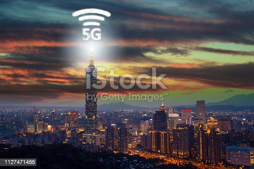 istock Network connection technology in the city, with 5g internet networking sign 1127471455