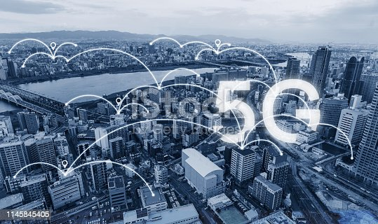 istock Network connection technology in the city, with 5g internet networking sign 1145845405
