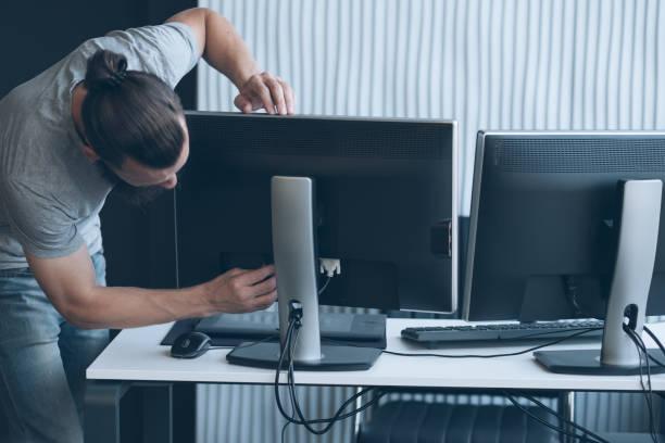 network engineer professional career man monitor stock photo