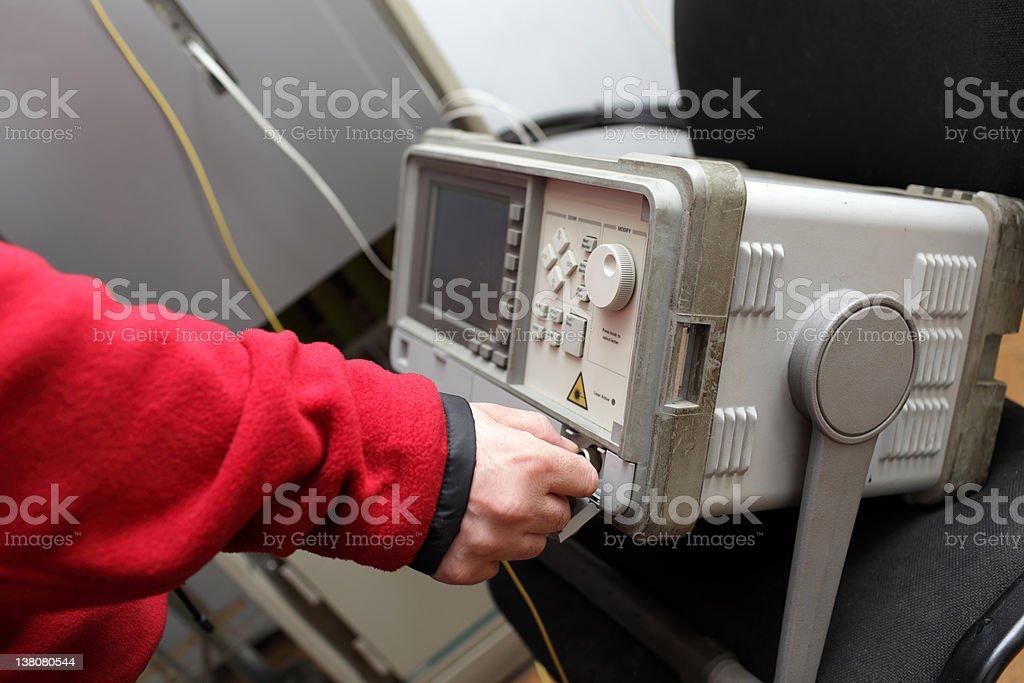 Network engineer touching reflectometer stock photo