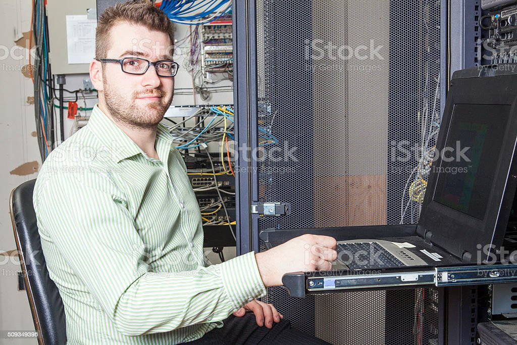 Network engineer working in server room stock photo