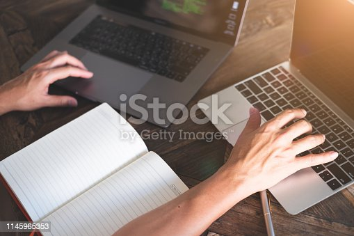 1170085960 istock photo Network engineers or technicians using laptop while analyzing server network and fix network problems. 1145965353