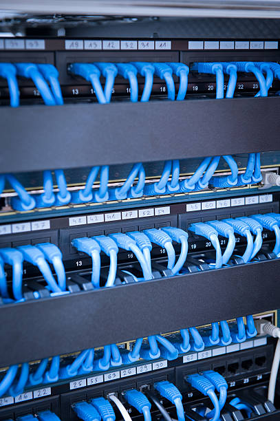 Network hub and cable with blue stock photo