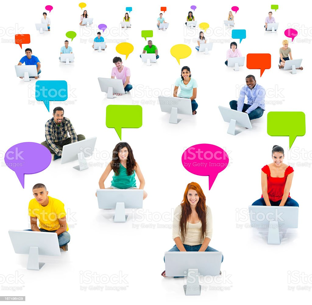 Network of youth at their computers with speech bubbles royalty-free stock photo