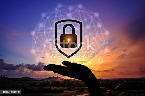 1068838170istockphoto Network security icon with graphic diagram on beautiful sunset background. 1062950196