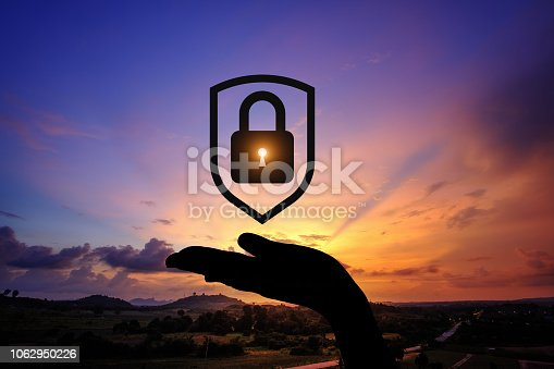 1068838170istockphoto Network security icon with graphic diagram on beautiful sunset background. 1062950226