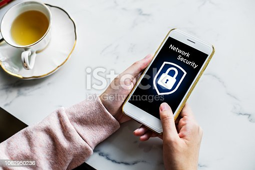 istock Network security icon with graphic diagram on mobile screen. 1062950236