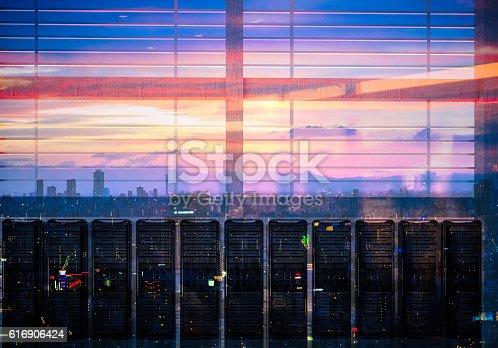 istock Network servers racks with skyline 616906424