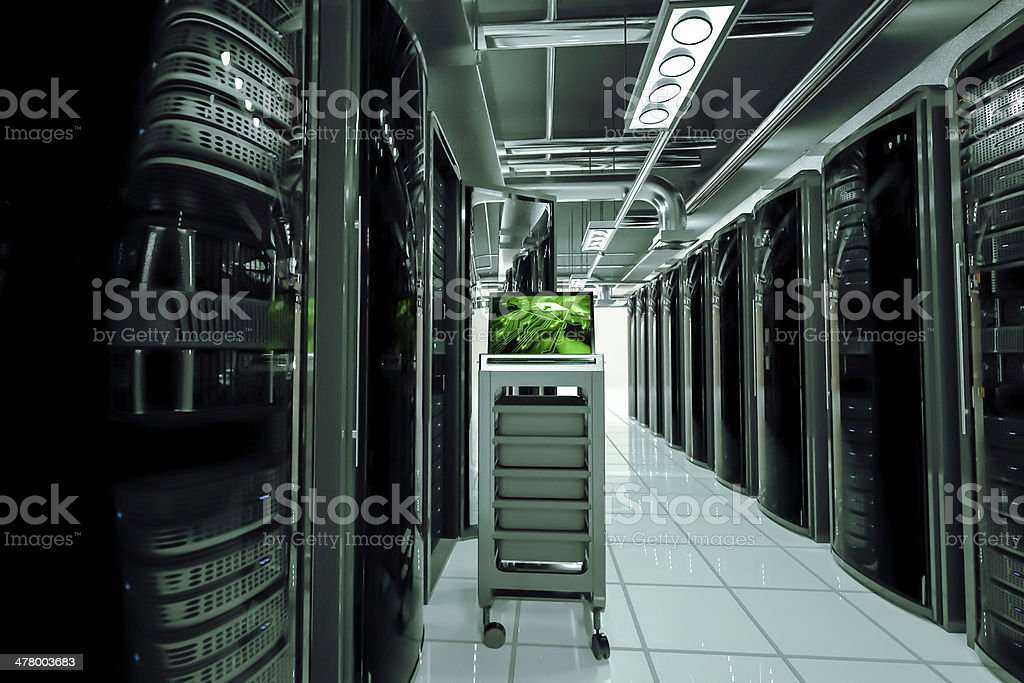 network servers racks with laptop,the photo on the laptop screen form...