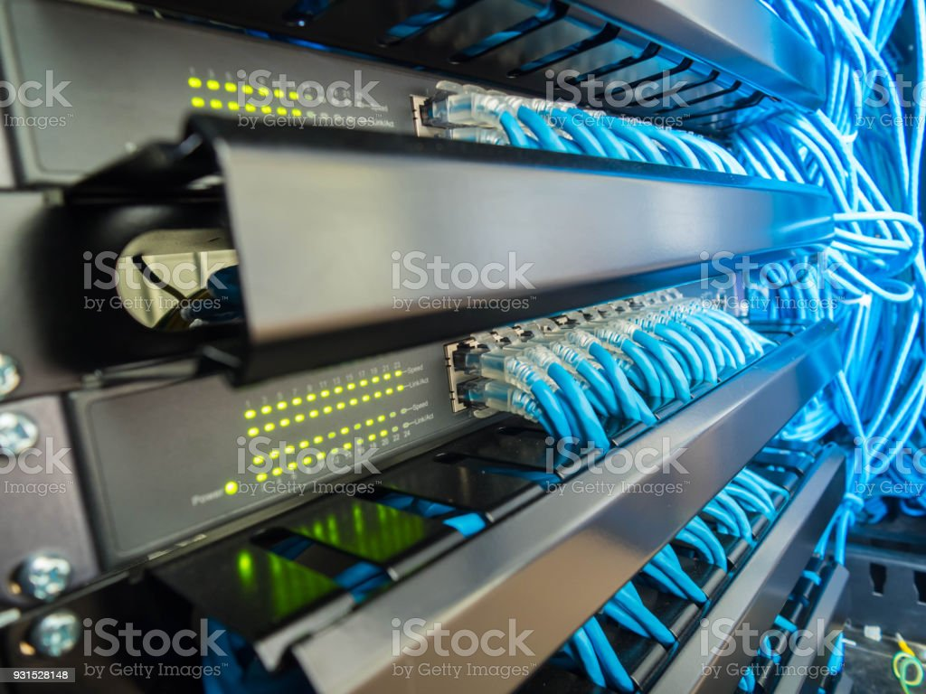 Network switch and ethernet cables connected stock photo