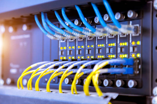 Network switch and ethernet cables,Data Center Concept. stock photo