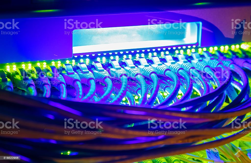 Network switch and UTP ethernet cables close-up in server room stock photo