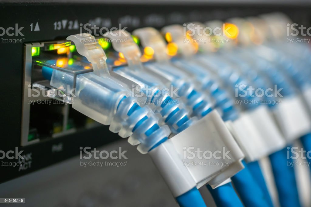 Network switch hub and ethernet cables connected stock photo