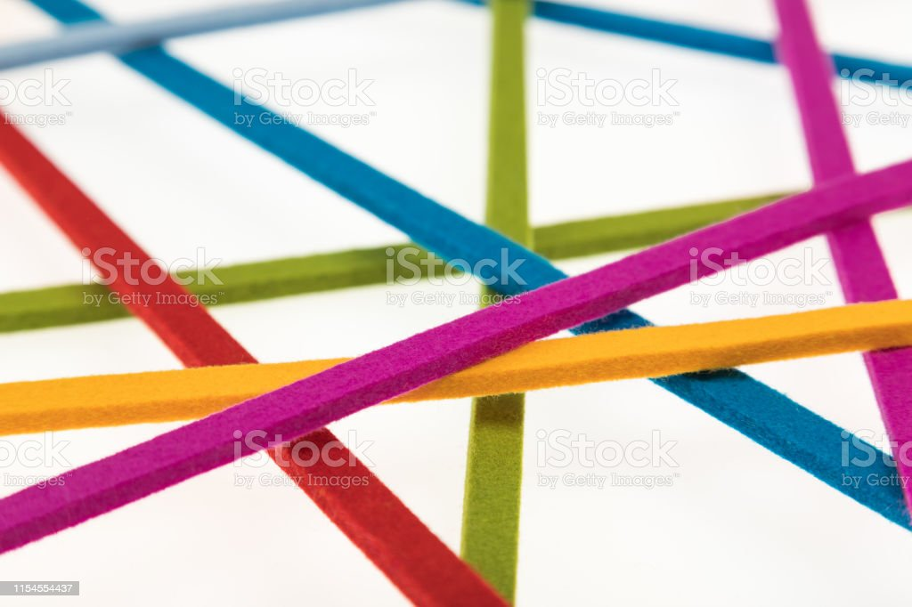 Multicolored ribbons in front of white background - Concept of...