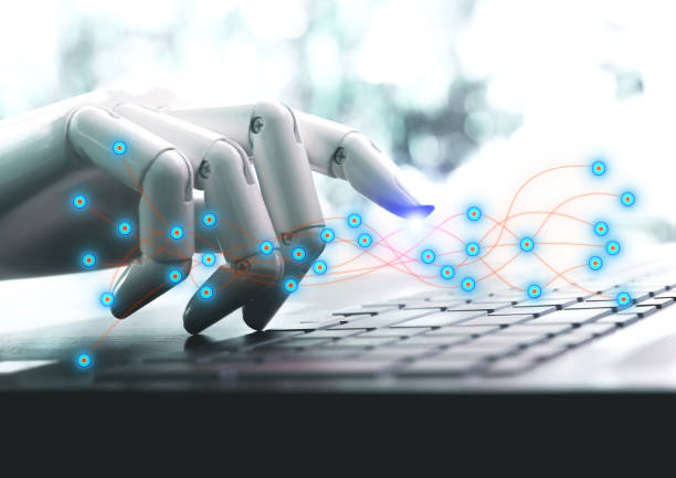 Network technology robot concept or robot hand chatbot pressing computer keyboard enter stock photo