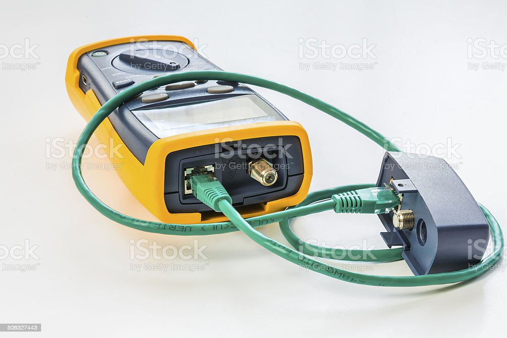 network tester with green RJ45 cable 5e connected for testing stock photo