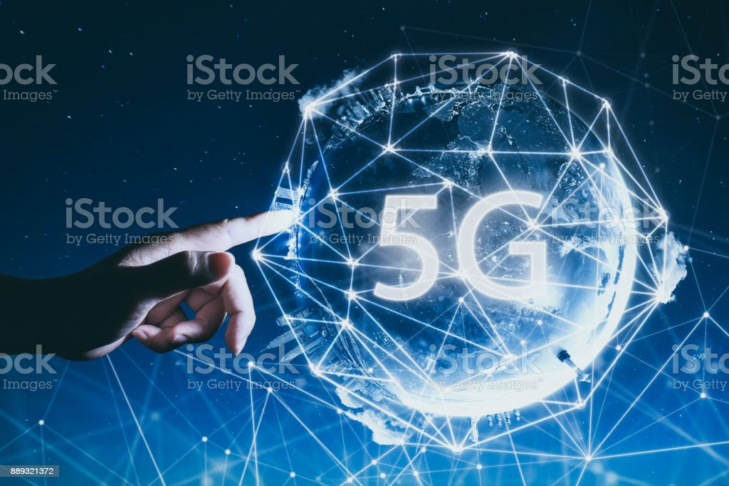 5G network wireless systems and internet of things with man touching Abstract global with wireless communication network on space background . stock photo