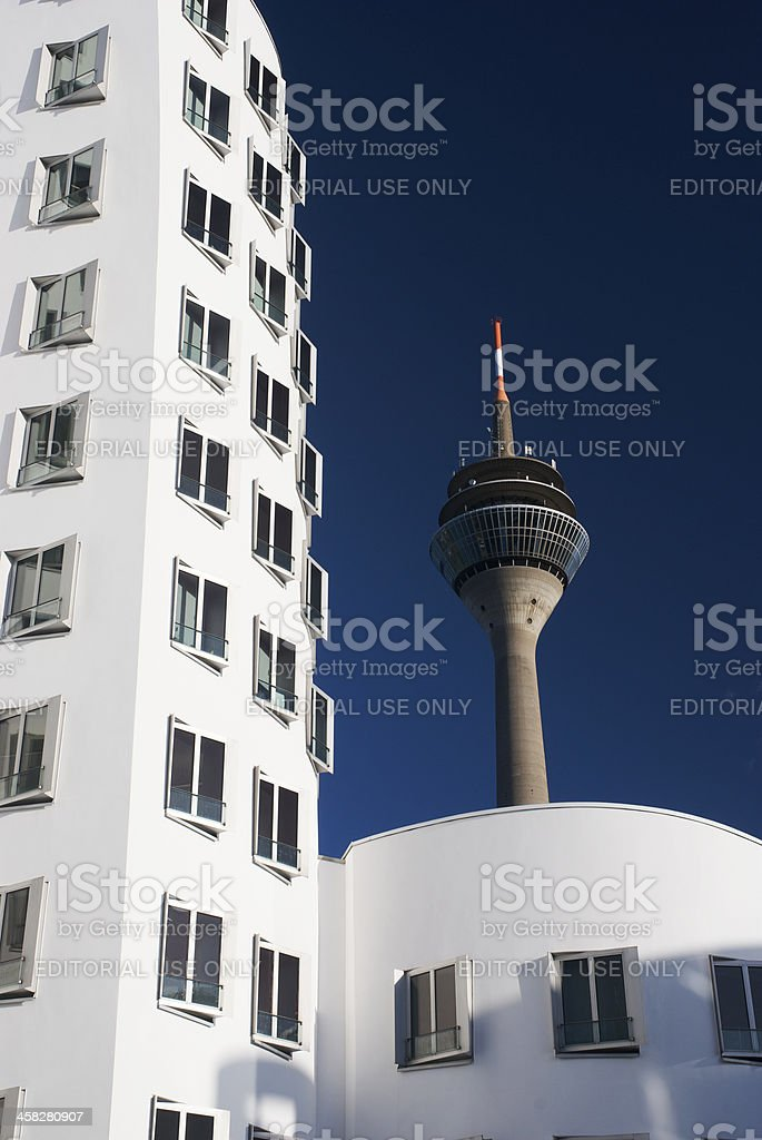 Neuer Zollhof buildings and Rhein Tower at MedienHafen, Dusseldorf royalty-free stock photo