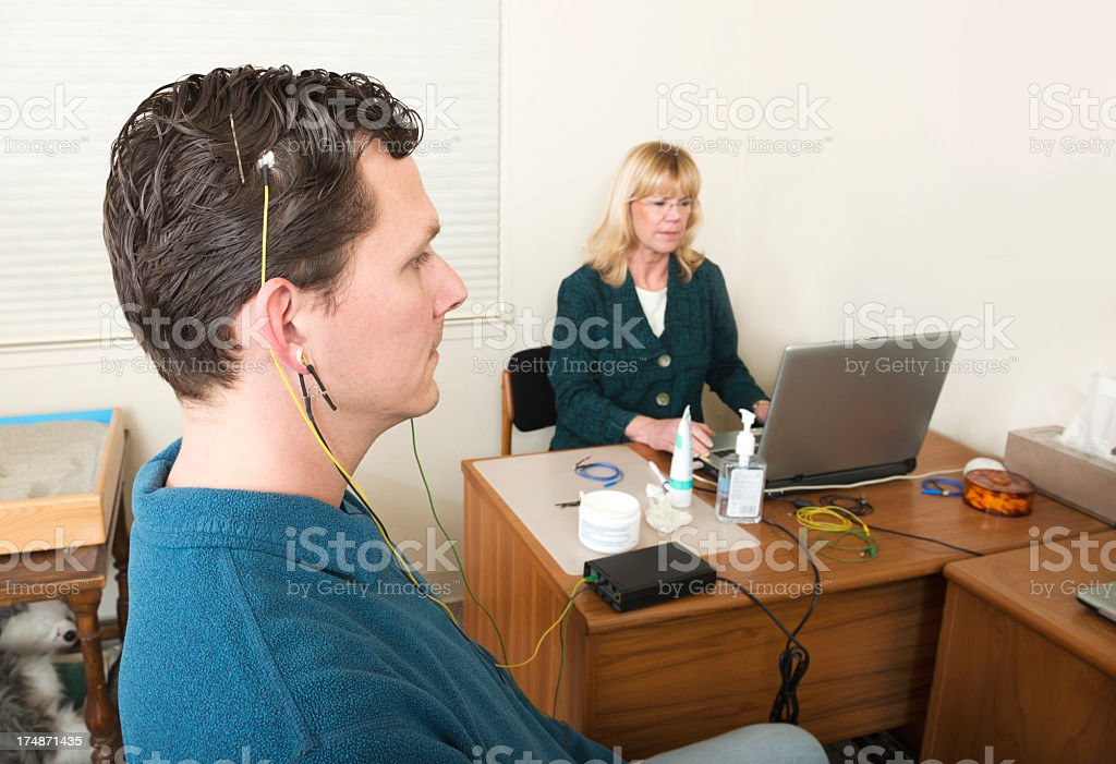 Neuro feedback patient being tested by doctor stock photo
