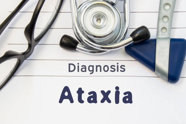 Neurological diagnosis of Ataxia. Neurological hammer, stethoscope and doctor's glasses lie on doctor workplace on sheet of notebook, labeled with the title of medical diagnosis of Ataxia Neurological diagnosis of Ataxia. Neurological hammer, stethoscope and doctor's glasses lie on doctor workplace on sheet of notebook, labeled with the title of medical diagnosis of Ataxia cerebellum stock pictures, royalty-free photos & images