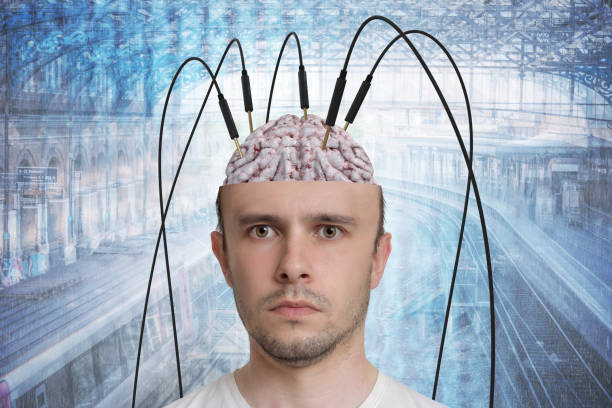 Neuroscience and brain research concept. Reconstruction of memory. Young man has cables and electrodes in his brain. stock photo