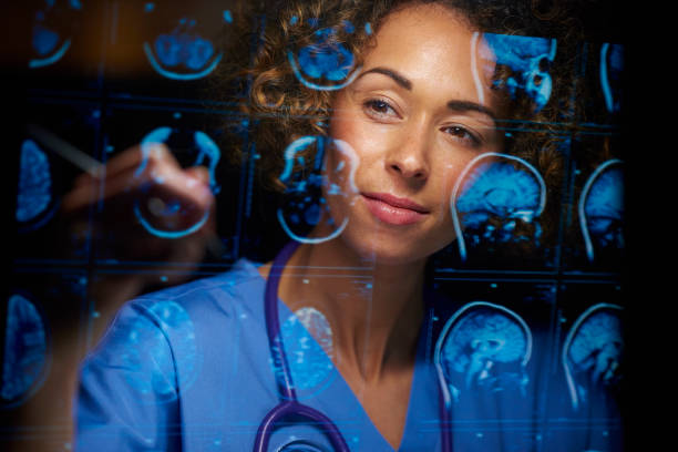 neurosurgeon checking mri scans stock photo