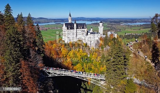 Fussen, Germany - October 14, 2017: View of Neuschwanstein Castle over Queen Mary's Bridge (Marienbrucke) at clear autumn day, Bavaria.