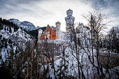 Hohenschwangau, Germany, December 9, 2013:  A wide angle view of famous Neuschwanstein Castle in the dead of winter.  This popular tourist site is located in southern Germany in Bavaria, near the Austrian border.