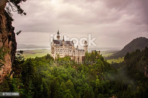 Bavaria, Germany- May 26th, 2014 : Neuschwanstein Castle is a 19th-century romantic eclecticism palace on a rugged hill above the village of Hohenschwangau near Füssen in southwest Bavaria, Germany. The palace was commissioned by King Ludwig II of Bavaria as a retreat and in honour of Richard Wagner