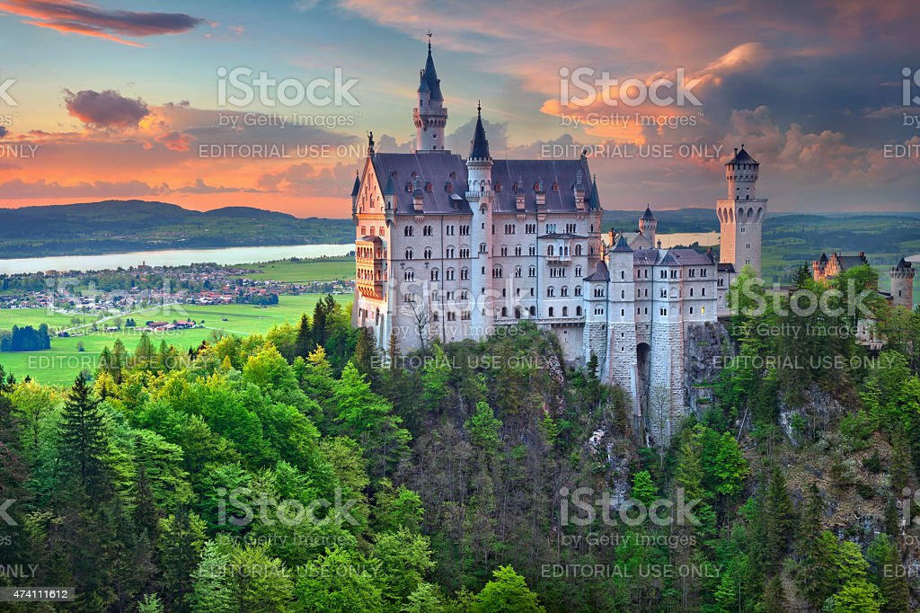 Neuschwanstein Castle, Germany. Hohenschwangau, Germany - May 9, 2015: view of Neuschwanstein Castle on may 9th near Hohenschwangau, Germany during spring afternoon surrounded by spring colours. 2015 Stock Photo