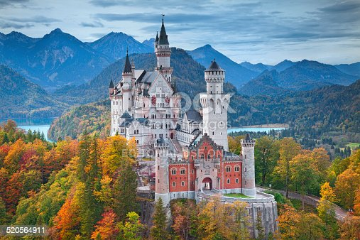 Hohenschwangau, Germany - October 7, 2014: view of Neuschwanstein Castle on october 7th near Hohenschwangau, Germany during autumn afternoon surrounded by fall colours.