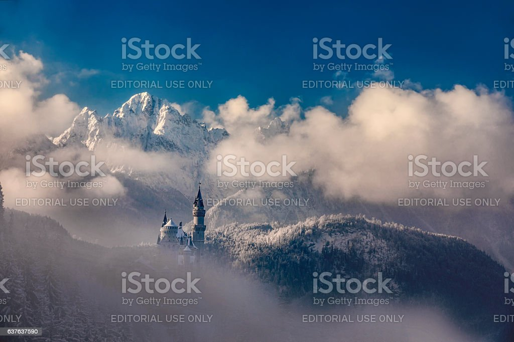 Neuschwanstein castle in Germany during misty winter morning stock photo