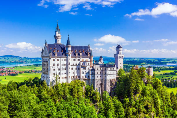 Neuschwanstein Castle Neuschwanstein Castle - June 17, 2019: Castle near Fussen, Germany. romanesque stock pictures, royalty-free photos & images
