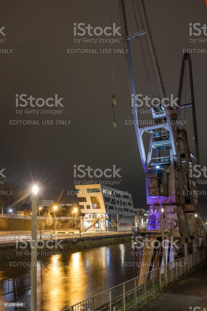 Neuss - Illuminated Cranes at Neuss Harbor, Germany, North Rhine Westphalia, Neuss, 23.01.2018 stock photo