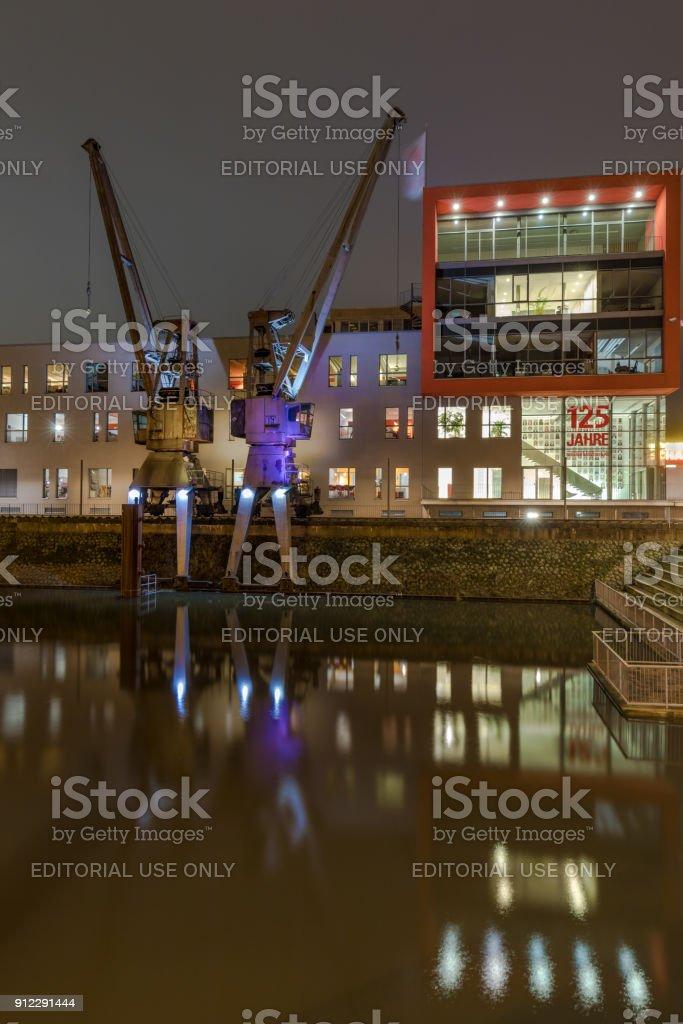 Neuss - Two Illuminated Cranes at Neuss Harbor, Germany, North Rhine Westphalia, Neuss, 23.01.2018 stock photo
